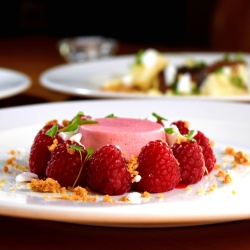 Raspberry pudding with fresh raspberries
