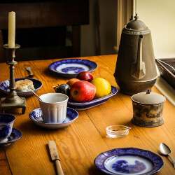 Table with tea service and fruit bowl