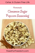 Pinterest mini image - Fresh popcorn sprinkled with cinnamon sugar seasoning in a bowl, with cinnamon sticks next to it