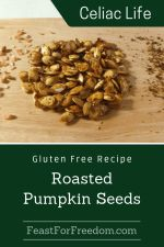 Pinterest mini image - Roasted pumpkin seeds on a wooden board sprinkled with ground pepper and pink salt