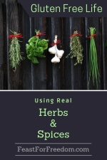 Pinterest mini image - Using real herbs and spices with fresh spices tied nicely and hung on a black rustic wall