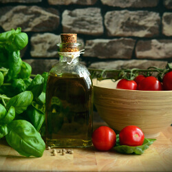 Bottle of olive oil with tomatoes on a vine
