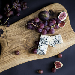 Fruit and blue cheese on a cutting board