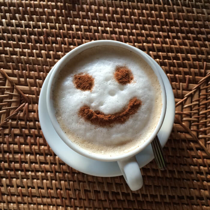Coffee with foam with a cocoa smiley face