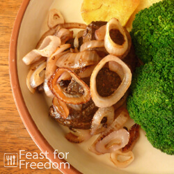Beef liver and onions with pan fried potatoes and broccoli