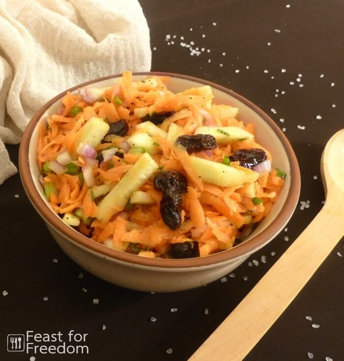 Fresh carrot and apple salad in a bowl