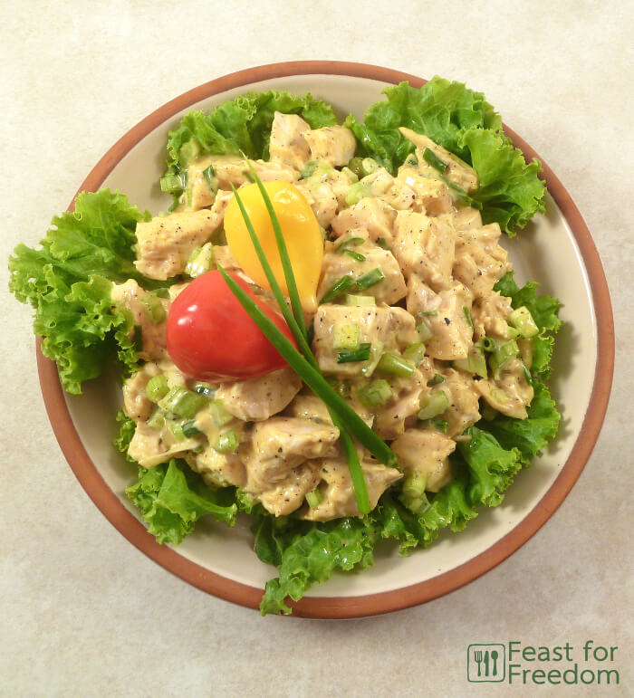 Chicken salad on a bed of lettuce on a plate