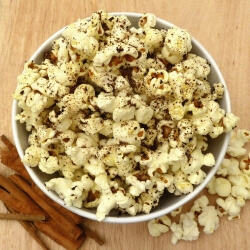 Popcorn in a bowl with a cinnamon topping