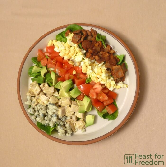 Fresh Cobb Salad on a plate, laid out in small rows