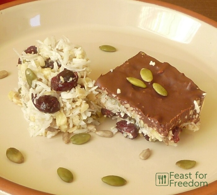 Coconut and nut squares, one that's plain, one that's topped with chocolate