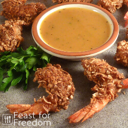 Coconut shrimp on a platter with honey mustard sauce