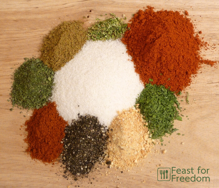 The spices for ff seasoning in little piles on a cutting board