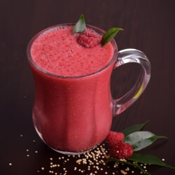 Raspberry and peach smoothie with a fresh raspberry garnish