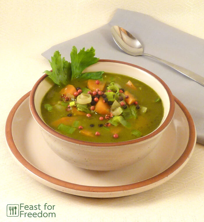 Leek soup in a bowl garnished with parsley