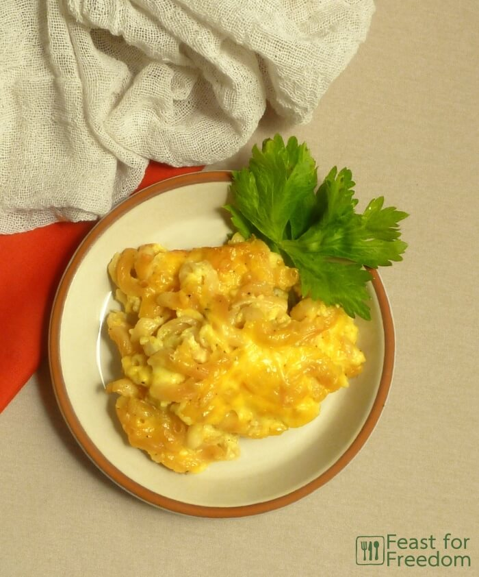 Baked macaroni and cheese on a plate garnished with parsley