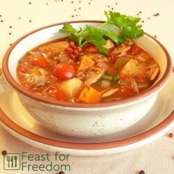 Manhattan tomato based clam chowder in a bowl garnished with parsley
