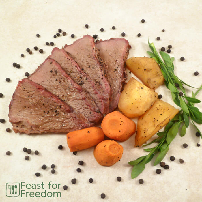 Roast beef with carrots and potatoes on a platter