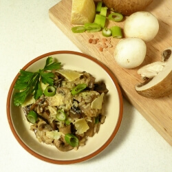 Mushroom risotto on a plate with fresh grated parmesan cheese