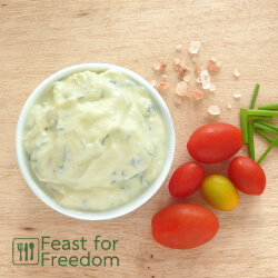Ranch dressing in a bowl beside cherry tomatoes
