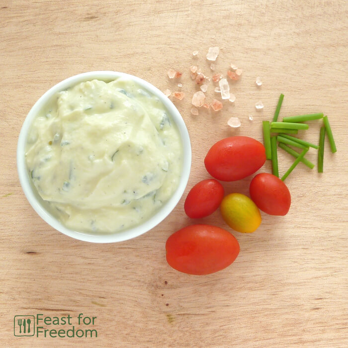 Ranch salad dressing in a bowl with cherry tomatoes