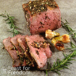 Roast beef garnished with rosemary
