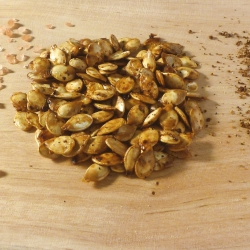 Roasted pumpkin seeds with sprinkled salt and spices