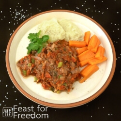 Swiss steak served with mashed potatoes and carrots